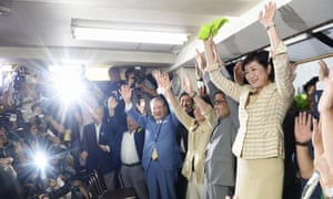 Yuriko Koike and her supporters celebrate her win in Tokyo.