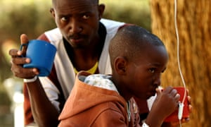 Patients await treatment at a makeshift cholera clinic in Harare, Zimbabwe