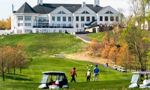 Golfers play a round at the Trump National club in Virginia, which was still still open to members who practise physical distancing this month, though the state governor issued a lockdown order for residents until 10 June.