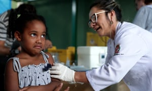 A child gets a vaccine against yellow fever at an outpatients clinic in Sao Paulo