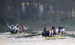 The Cambridge crew, left, celebrate as they cross the line to win the race.