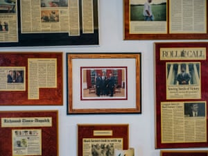 John Boyd Jr's home is decorated with stories and photos of his trips to Washington DC to meet with lawmakers and presidents in his fight for black farmers' rights.