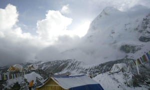 Small avalanche on Pumori as seen from Everest base camp, Nepal, on Sunday. Climbers left stranded on Everest were again in fear for their lives after aftershocks triggered further avalanches.