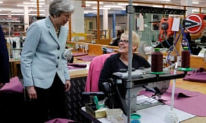 Theresa May speaking to a worker during a visit to Boss Design in Dudley as part of the Conservative Party's local election campaign