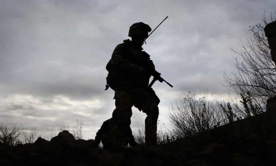 A Royal Marine on patrol in the Sangin district of Afghanistan.