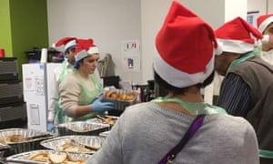 Volunteers at the Curve community centre near Grenfell Tower serve Christmas lunch to more than 250 people from North Kensington, including survivors of June's fire.