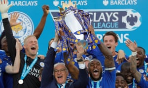 Leicester manager Claudio Ranieri and Captain Wes Morgan lift the Premier League trophy