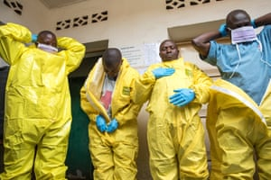 The Red Cross trains specialist burial teams in remote communities to bury people in a safe and dignified manner, all while wearing protective suits and equipment.