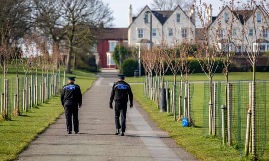 Police officers walk through Stanley Park in Liverpool