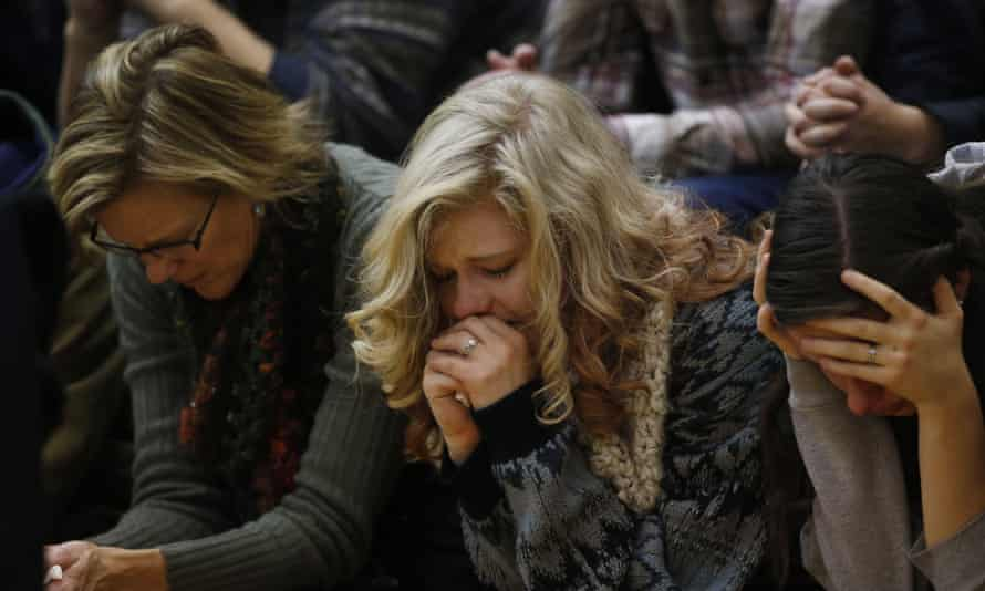 Women at vigil in Colorado Springs on Saturday for the victims of the Planned Parenthood clinic attack.