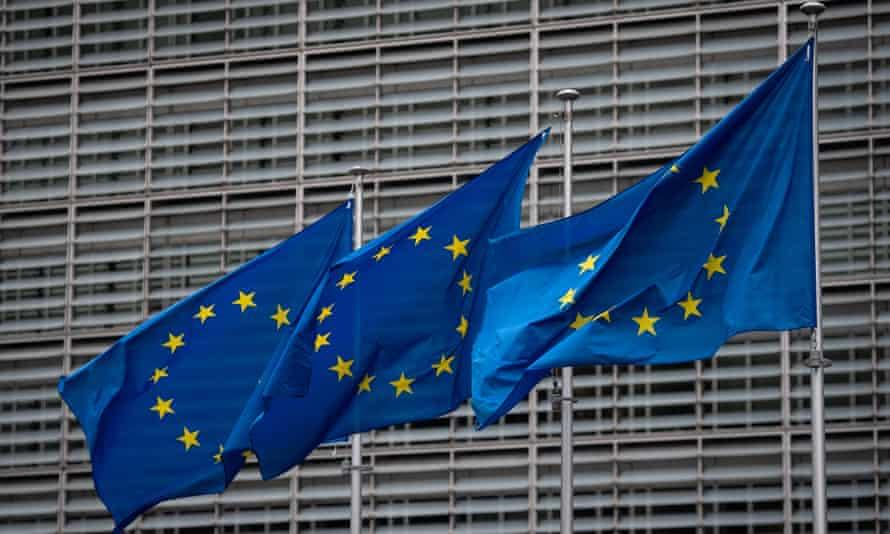 EU flags outside the European parliament buildings