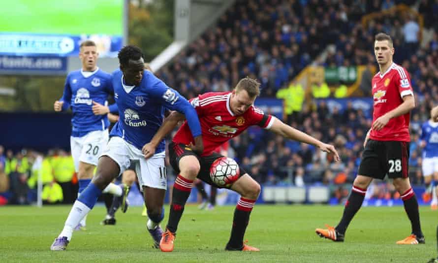 Phil Jones attempts to shield the ball from Romelu Lukaku during Man Utd's 3-0 win at Everton.