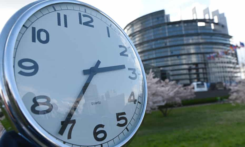 A clock held outside the European parliament in Strasbourg, France