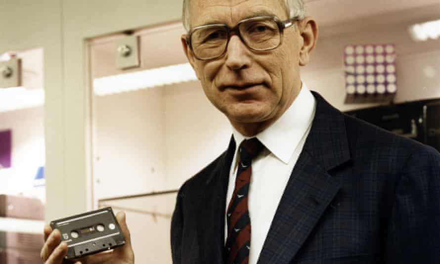 Lou Ottens holding an audio cassette in 1988, a quarter of a century after it make its debut at a Berlin trade fair.