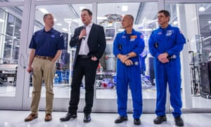 Elon Musk with Nasa's Jim Bridenstine (left) and astronauts Doug Hurley and Bob Behnken at SpaceX HQ in California
