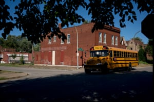 A school bus passes through a neighborhood in south St. Louis on Friday, Sept. 13, 2019, a block from where 3-year-old Kennedi Powell was shot in June of this year. The toddler was killed in a drive-by shooting, while another bullet injured her 6-year-old neighbor. At least 13 children have died of gunshot wounds in St. Louis city this year, and six children in St. Louis Country have been killed by gunfire.