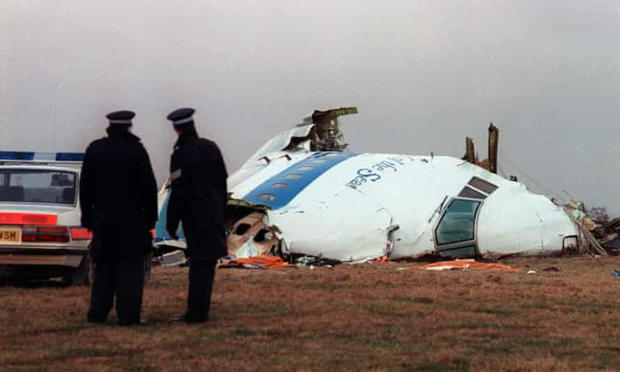 Policemen look at the wreckage of the 747 Pan Am airliner that exploded and crashed over Lockerbie in December 1988.