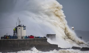Waves crash against the harbour wall during Storm Freya off the coast of Porthcawl in Wales.