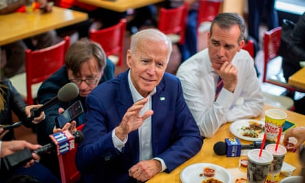 Joe Biden talks to reporters with the Los Angeles mayor, Eric Garcetti, during a campaign stop at a King Taco shop in Los Angeles last month.