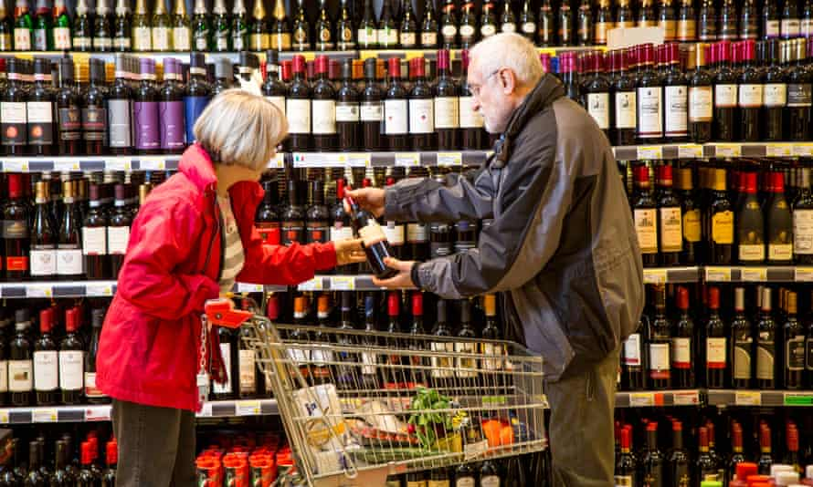couple buying wine