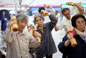 Older people practise social distancing during an event marking Respect for the Aged Day in Tokyo