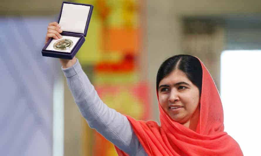 Malala Yousafzai displays her medal at the awarding ceremony of the 2014 Nobel peace prize in 2014.