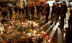Parisians gather near the Bataclan music venue in Paris to commemorate the victims of the terrorist attack