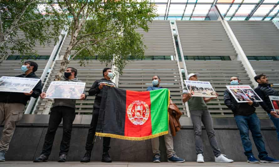 Afghan former interpreters protest in front of the Home Office in London, demanding that evacuations from Kabul continue.