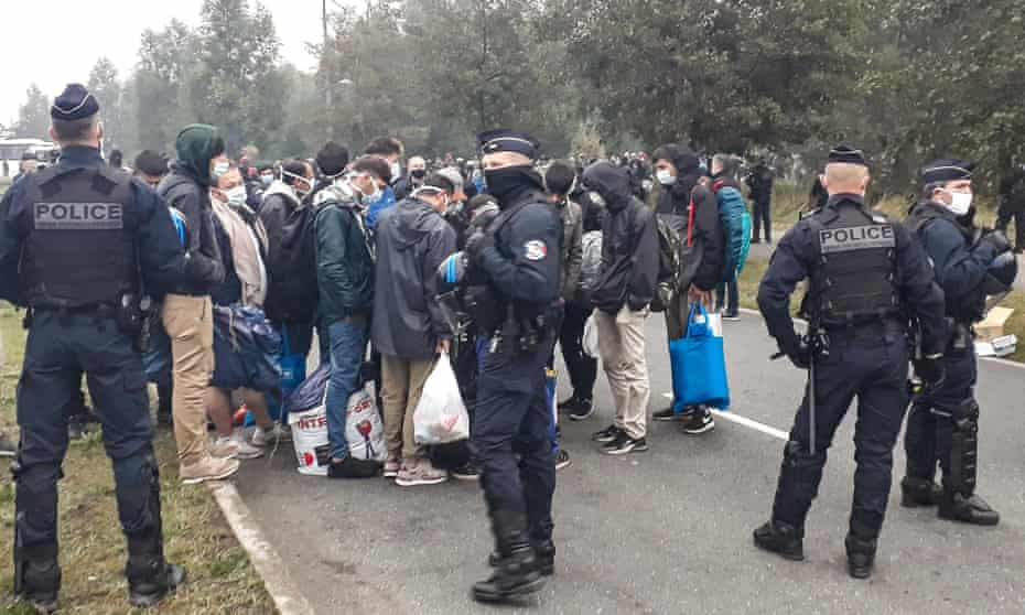 Police moved about 700 migrants after they dismantled their camp in Calais, northern France.