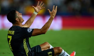 Cristano Ronaldo crises out in anguish after receiving a red card card on his Champions League debut for Juventus.