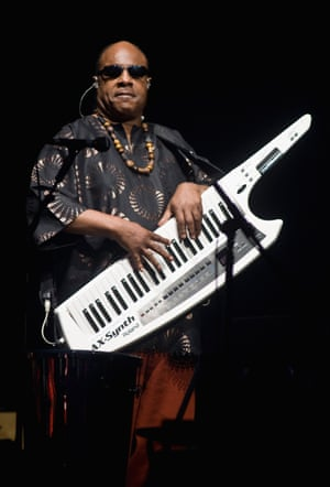 Stevie Wonder in swirled shirt, beads and – crucially – keytar, on stage in 2010.