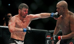 Britain's Michael Bisping punches Anderson Silva during their fight at the UFC fight night at the O2 Arena in London on 27 February 2016.
