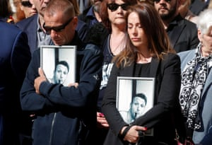 Paris, France Family members of soldiers Cedric de Pierrepont and Alain Bertoncello, killed in a raid to free hostages in Burkina Faso last week, attend a national tribute at the Hotel des Invalides