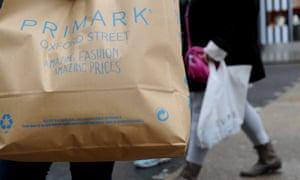 Shoppers leaving Primark on Oxford Street in London