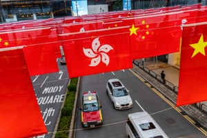 Hong Kong and Chinese flags outside a building in the city's Tsim Sha Tsui district