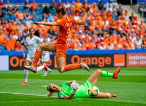 New Zealand's goalkeeper Erin Nayler collects under pressure from Netherland's Vivianne Mitedema.