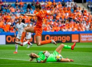 New Zealand's goalkeeper Erin Nayler collects under pressure from Netherland's Vivianne Mitedema.