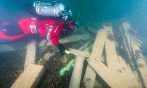 A diver surveys items from the Erebus.