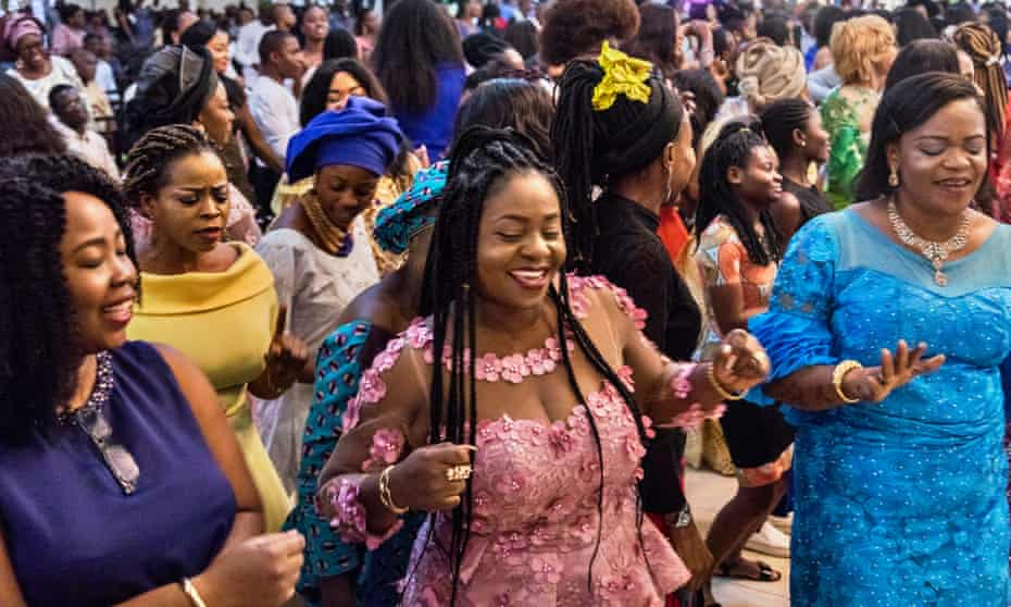 The congregation dances during Chris Okotie's service in Lagos on Sunday.