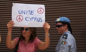 A woman stands beside a UN peacekeeper