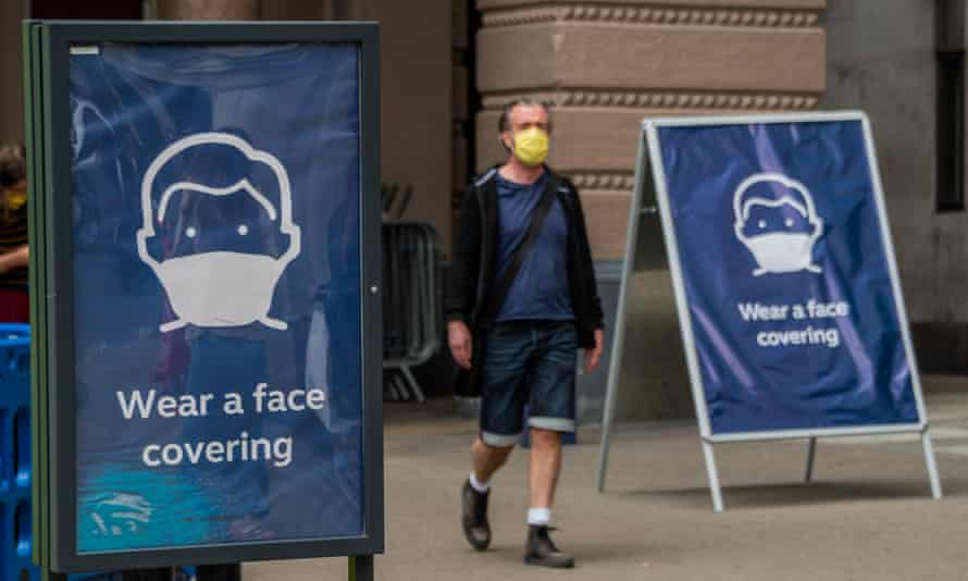 'Wear a face covering' is now the message on street posters