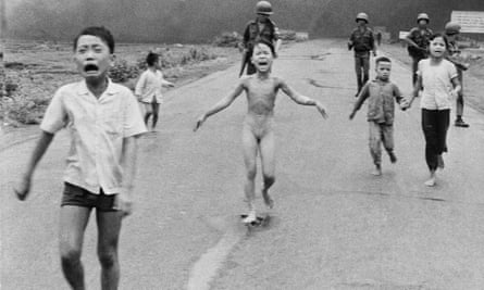 iconic image of Kim Phuc, a naked and badly burnt Vietnamese girl running  from a napalm attack