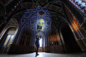 A visitor takes pictures inside the Castle of Sammezzano in Leccio