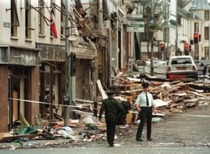 Police officers stand among the rubble after the car-bomb attack in Omagh, Northern Ireland, in August 1998.