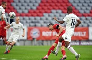 Robert Lewandowski (second right) heads home Bayern Munich's third.