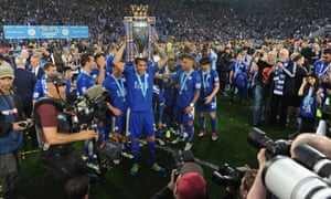 Leicester City players lift the Premier League trophy at a packed King Power Stadium.