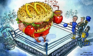 Cartoon of McDonald's hamburger wearing boxing gloves in a boxing ring.