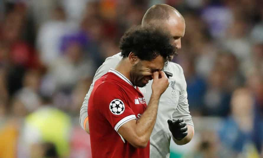 Mo Salah walks from the field with tears in his eyes after a sustaining an injury during a tussle with Real Madrid's Sergio Ramos.