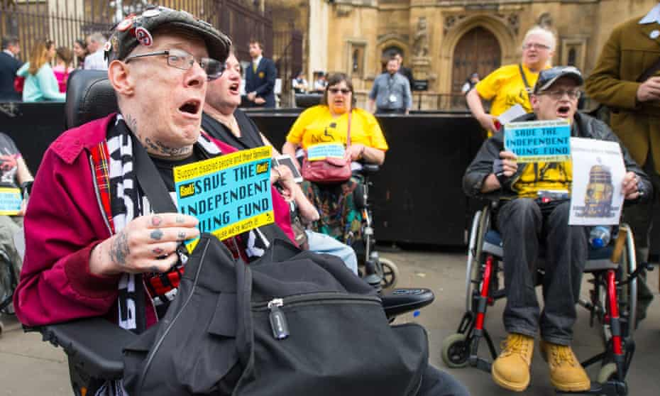 People in wheelchairs protesting outside parliament on 24 June 2015