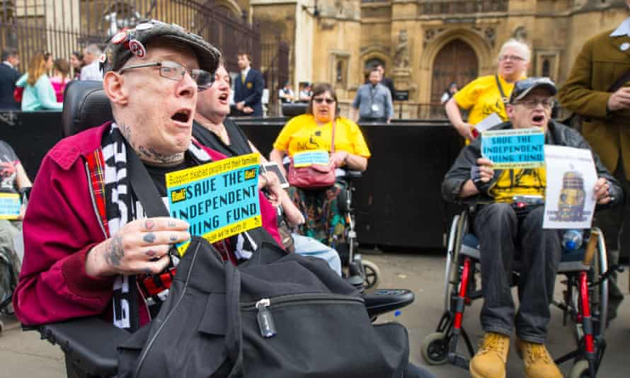 A protest by disability rights campaigners in Westminster in June 2015